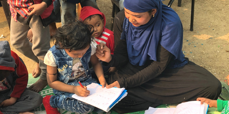 Fathima and her mom learn at CERI's community center.