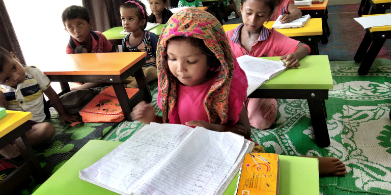 Children learning at CERI's community center in India.