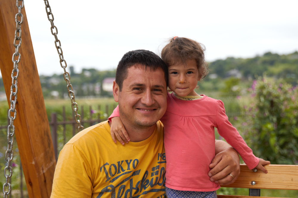 Father with foster child in Moldova